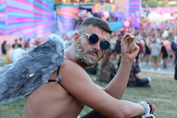 Fancy looking male smoking at music festival