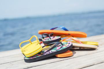 flip-flops on a pier