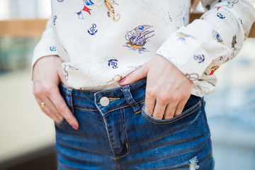 Girl holds her hands in jeans pocket