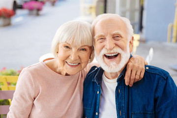 Strong relationships. Gay senior couple making laugh and looking at camera Fototapete