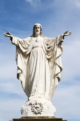 Jesus Christ with open arms statue in front of Pilgrimage Basilica of the Assumption of the Virgin Mary and St. Cyril and Methodius at Velehrad Monastery, Moravia, Czech Republic
