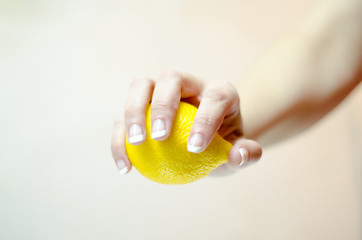 woman hand keep fresh lemon