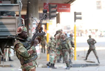 Soldiers open fire to disperse crowds of the opposition Movement for Democratic Change supporters outside the party's headquarters in Harare
