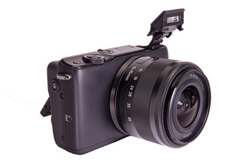 Mirrorless photo camera isolated on white background