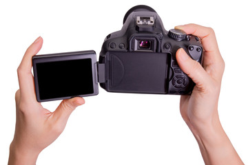 Hands holding the vari angle lcd dslr camera on white background,include clipping path