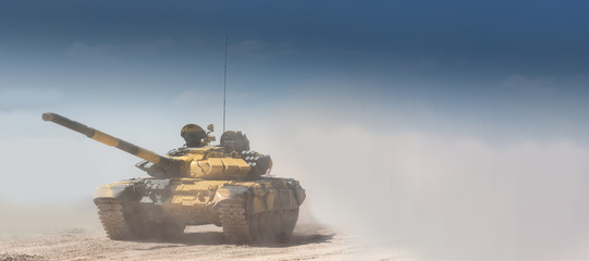 Military or army tank ready to attack and moving over a deserted battle field terrain. a lot of dust. copyspace