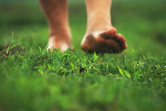 feet walking on the green floor.