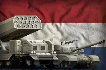 Netherlands heavy military armored vehicles concept on the national flag background. 3d Illustration