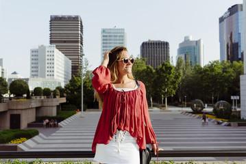 Stylish woman leaning on handrail
