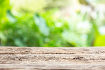 Empty space of top vintage wooden table or counter and sunny abstract blurred bokeh background