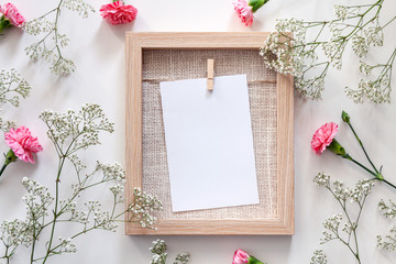 A wooden mockup frame surrounded by flowers