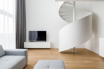 Tv living room with stairway