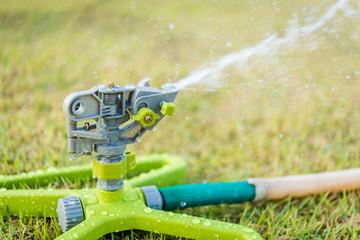 Sprinkler on the grass field