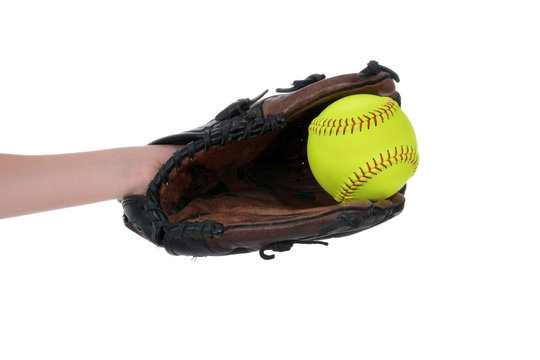 girl catching softball in glove isolated white background