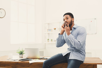 Young black businessman having phone talk