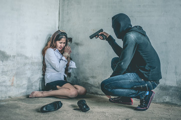 bandit with masked holding gun to Business woman tied.rope hostage concept.