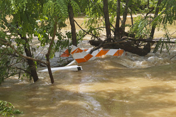 Barricade Submerged in Flooded River