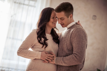 Pregnant woman posing with her husband