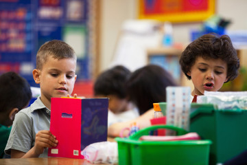 Students reading in a kindergarten classroom.