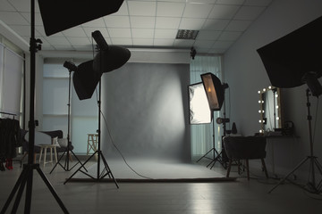 Interior of modern photo studio with professional equipment