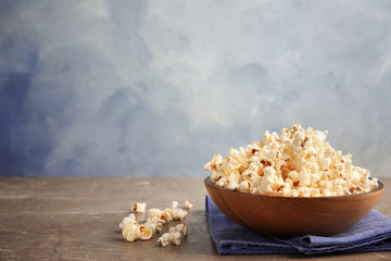 Bowl of tasty fresh popcorn on table