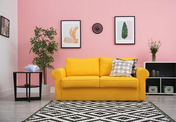 Modern living room interior with comfortable yellow sofa near color wall Fotoväggar