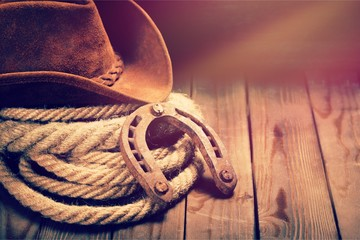 Metal horseshoe and cowboy hat