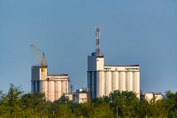 White grain elevator against blue sky