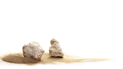 stones in sand pile isolated on white background and texture