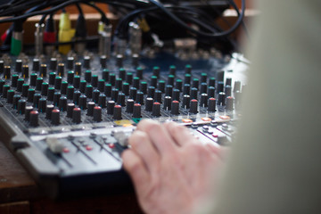 Sound operator during his work with sound control system