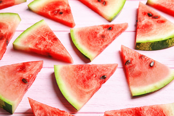 Composition with watermelon slices on wooden background
