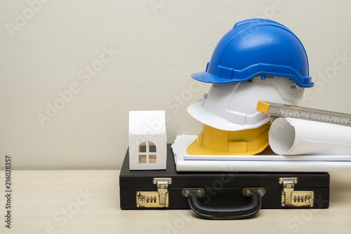 Engineering accessories helmets house paper model business bag engineering accessories helmets house paper model business bag blueprint on wood malvernweather Image collections