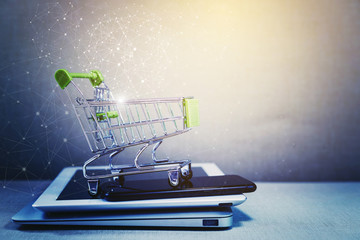 Online shopping background. E-commerce marketing technology, shopping cart on stacked mobile, tablet and laptop with connection line icon. Worldwide business. Global communication.