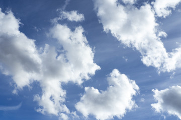Blue sky background with clouds. Image of clear blue sky and white clouds on day time for background usage.