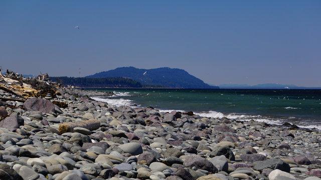 The Olympic Coast of Washington along the Strait of Juan de Fuca seen from the rocky beach of Ediz Hook at Port Angeles harbor