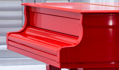 Side view of a Red Grand piano closed cover