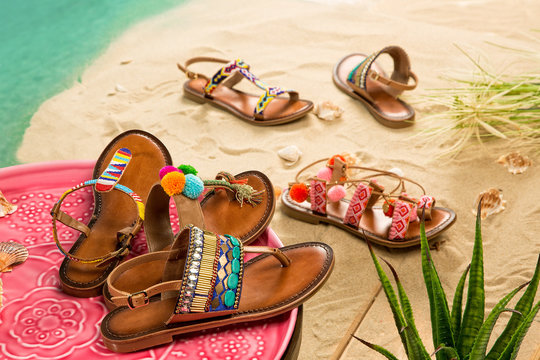 Colorful Sandals with Sand Beach Background