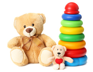 plastic toy pyramid with toy teddy isolated on white background