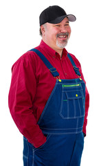 Smiling relaxed worker or farmer in overalls