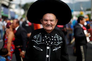 A mariachi participates in the opening parade of the festivities of El Divino Salvador del Mundo (The Divine Savior of The World), patron saint of the capital city of San Salvador