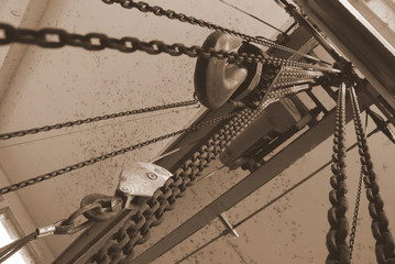 hanging chains  / hanging chains and two hooks in sepia color