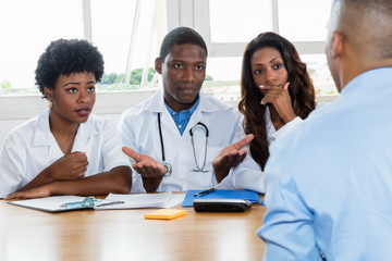 Group of african american doctors with patient