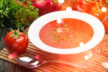 Fresh tomato soup on desk
