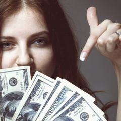 Best motivation is money. Happy businesswoman working for the money