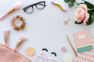 flat lay pink composition with copy space, blank note, cosmetics, makeup tools, glasses and rose on white background. beauty, fashion, party and shopping concept. lettering or text. Blog background.