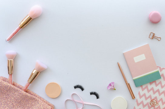 flat lay pink composition with cosmetics, makeup tools and accessory on white background. beauty, fashion, party and shopping concept. Copy space for lettering or text. Blog background.