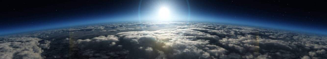Sunrise over the planet. Panorama of clouds under the sun.