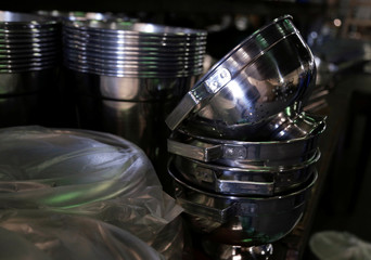 Aluminium utensils are pictured at a factory for household items in Capiata