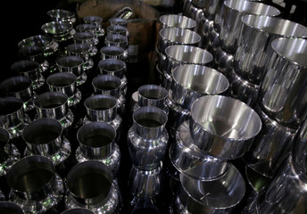 Utensils are pictured at a factory for household items in Capiata