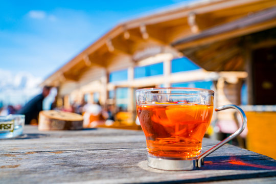 Hot tea cup on the terrace in the mountains ski resort.